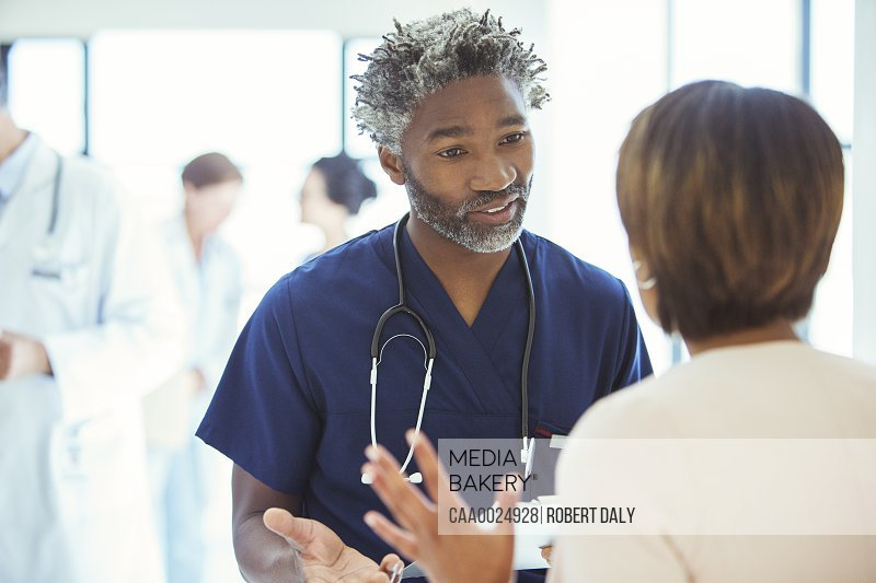Doctors talking face to face in hospital
