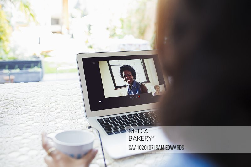 Women video conferencing on laptop screen