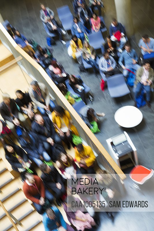 Defocused overhead view of conference audience