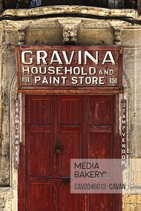 Pre-WW2 old wooden shop sign in Valletta<br><br><span style='color: red'>Editorial Use Only.</span><br><br>