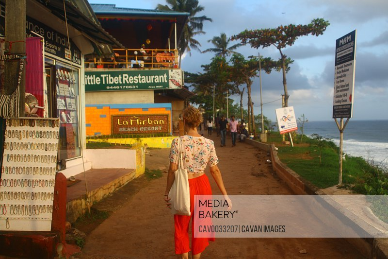 woman walking on Varkala street.<br><br><span style='color: red'>Editorial Use Only.</span><br><br>