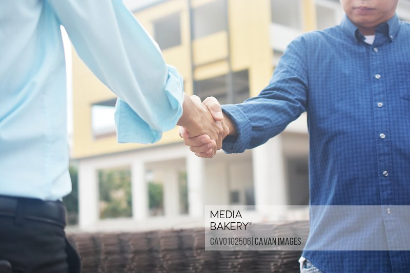 Close up businessman Shake hands agreement business deal corporate