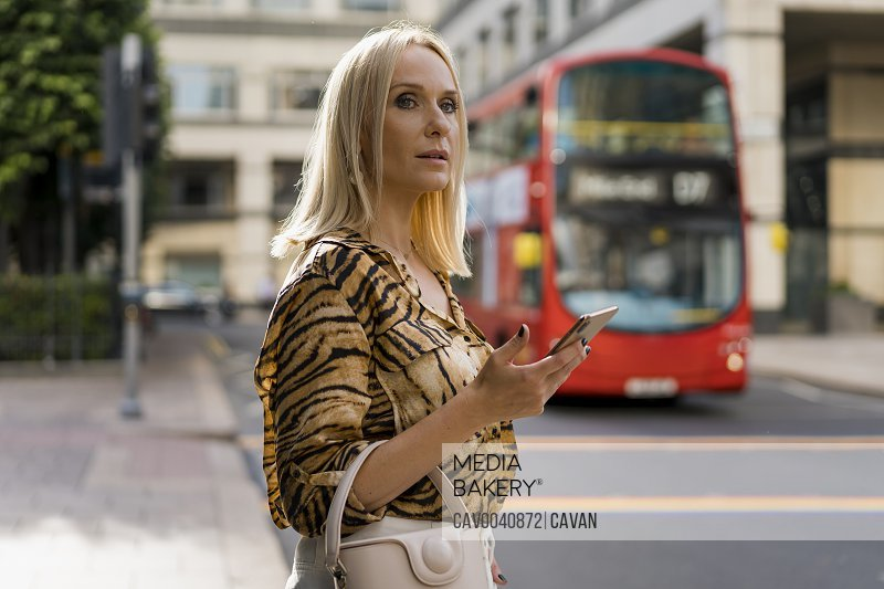 Businesswoman waiting for a bus in London