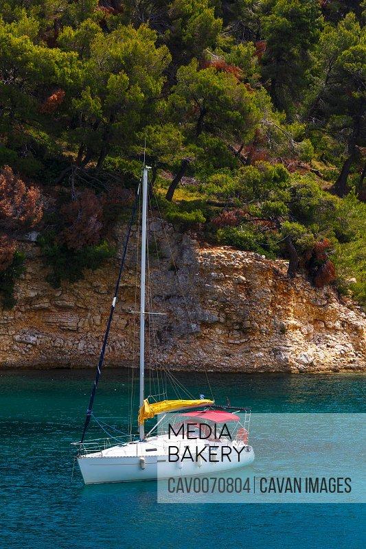 Sailboat at the coast near Patitiri village on Alonissos island.