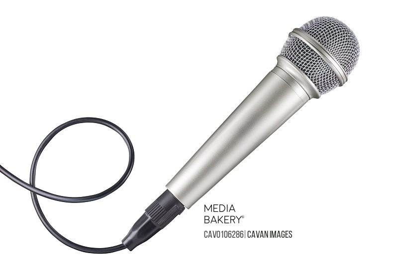 Microphone and cable isolated on white background. full depth of field