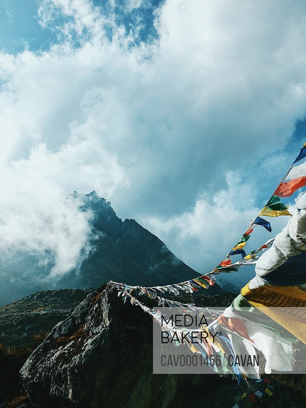 Cloudy mountain range with prayer flags