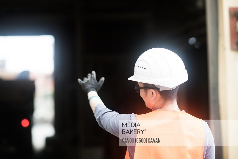 young worker in a concrete factory
