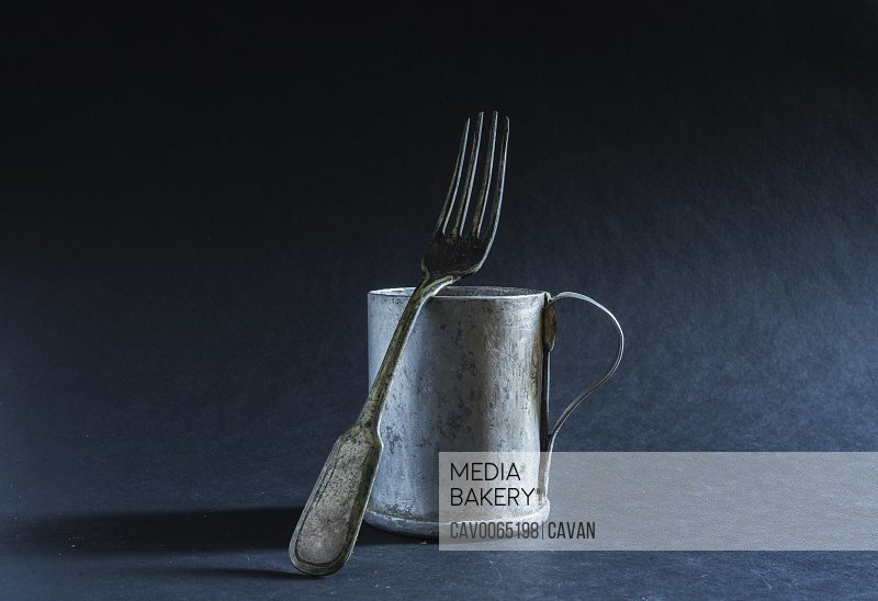 old aluminum cup and fork