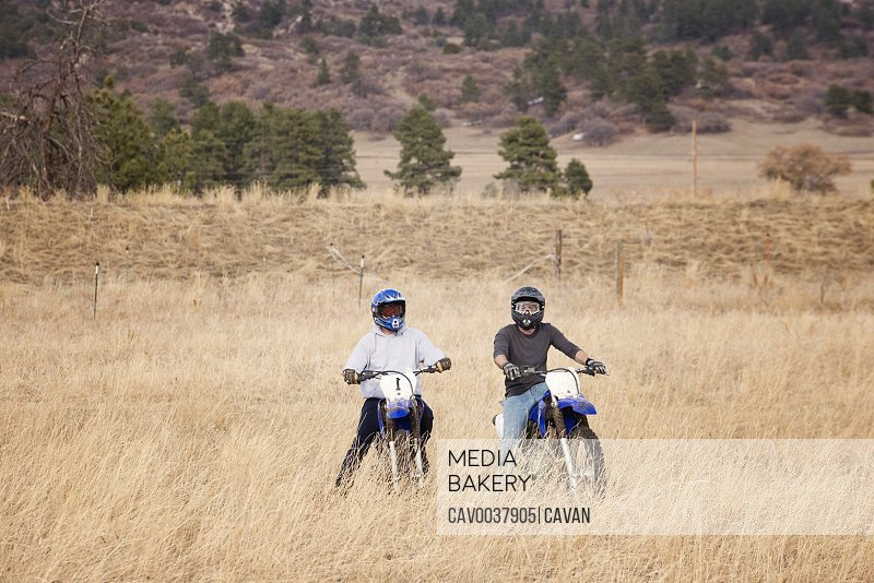 Two Young Men Dirt Biking in the Foothills in Colorado
