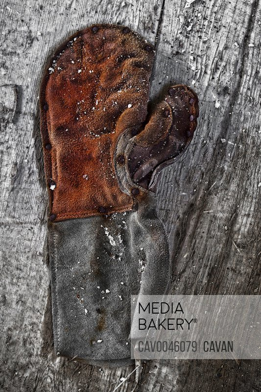 Old sail seamster's glove at abandoned Chinese sweat shop
