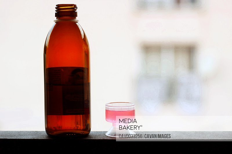 Healthcare and medicine concept - Bottle of cough syrup.