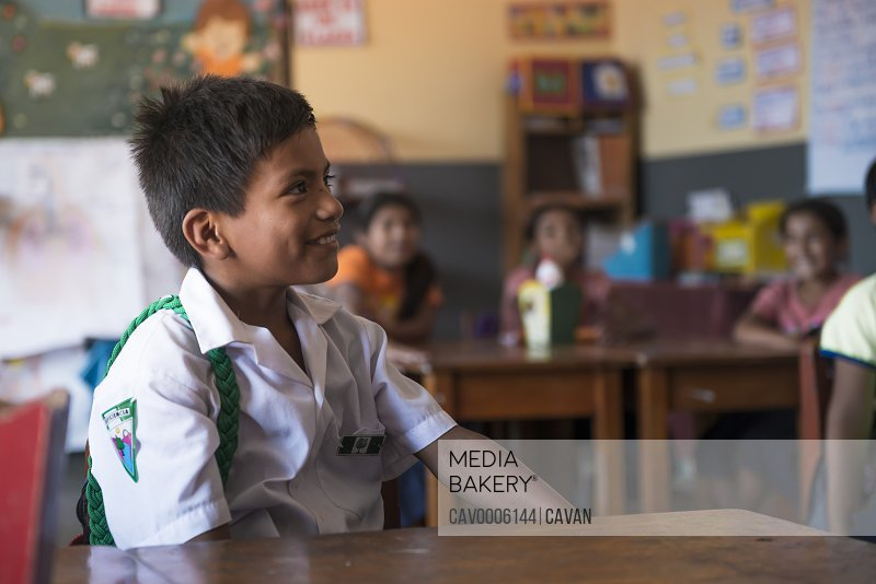 Peruvian boy paying attention to his teacher in the classroom<br><br><span style='color: red'>Editorial Use Only.</span><br><br>