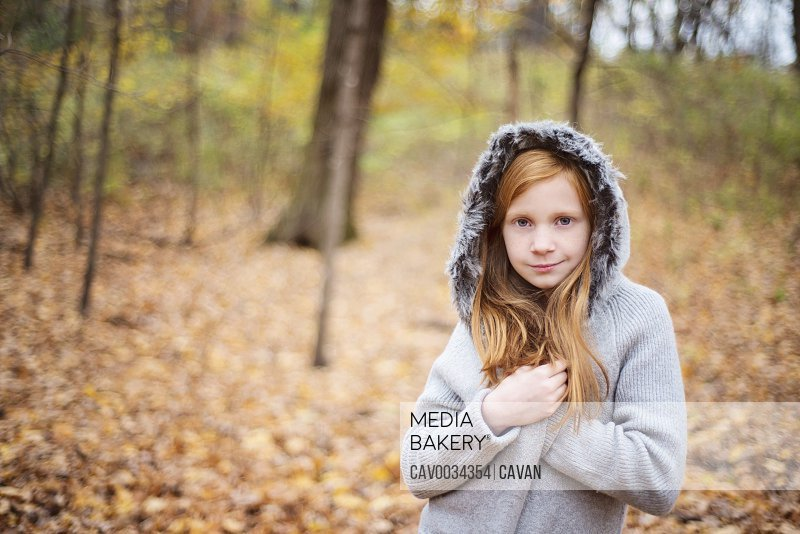 Young Red Hair Girl in sweater Outside in Fall.