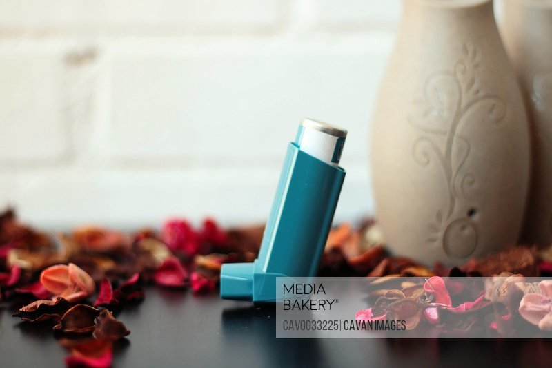Medicine and health concept: Blue inhaler.