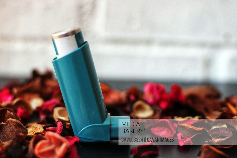 Medicine and health concept: Blue inhaler.