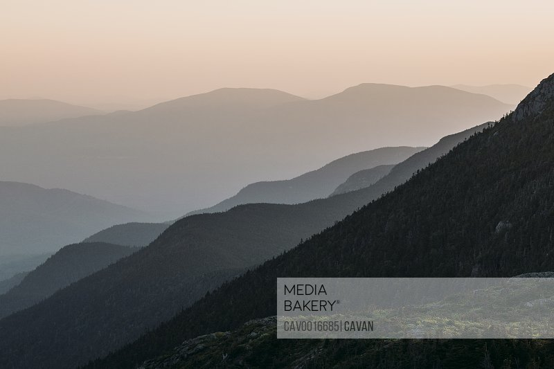 Mountains recede into the distant haze at sunset, Bigelow, Maine.