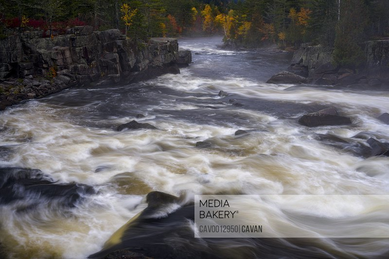 River rapids through a gorge with fall colors