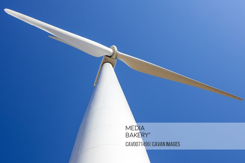 Wind Turbine against blue from low angle