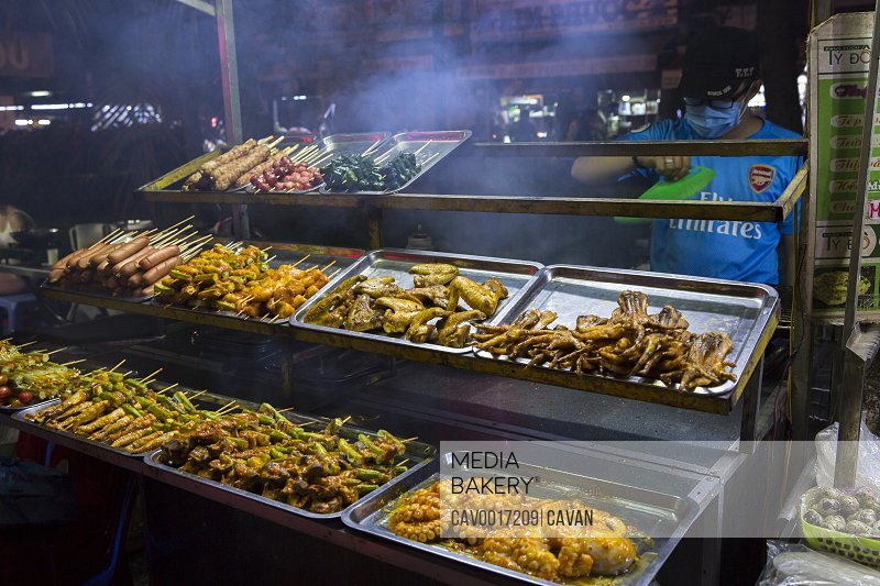 Cooked mat and seafood are displayed at a night market in Vietnam. <br><br><span style='color: red'>Editorial Use Only.</span><br><br>