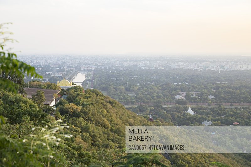 Mandalay's cityscape viewed from Mandalay hill during sunset, Myanmar
