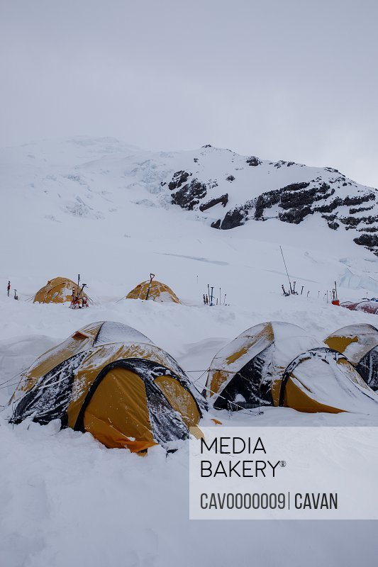 Snow Covers Climbers' Tents After a Storm on Mount Rainier