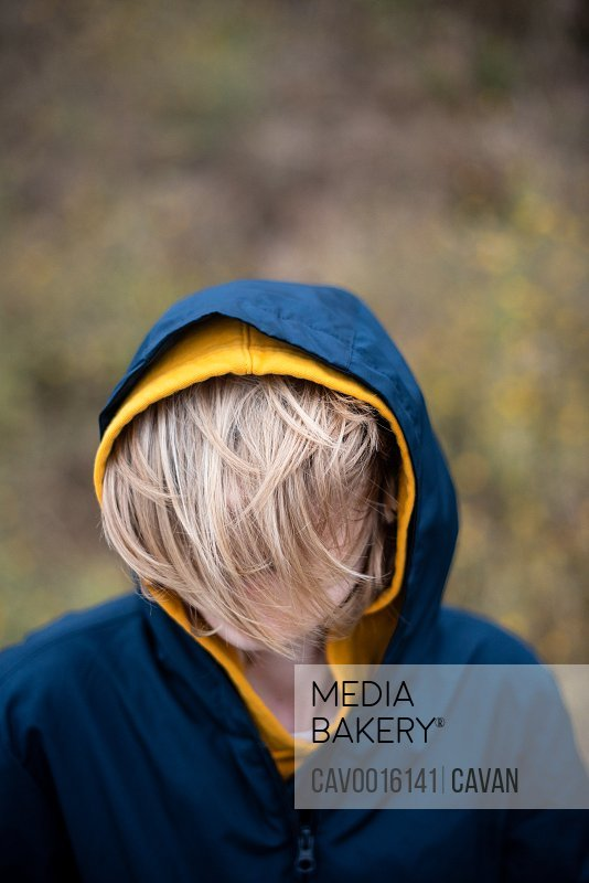 Portrait of tween with hair covering face