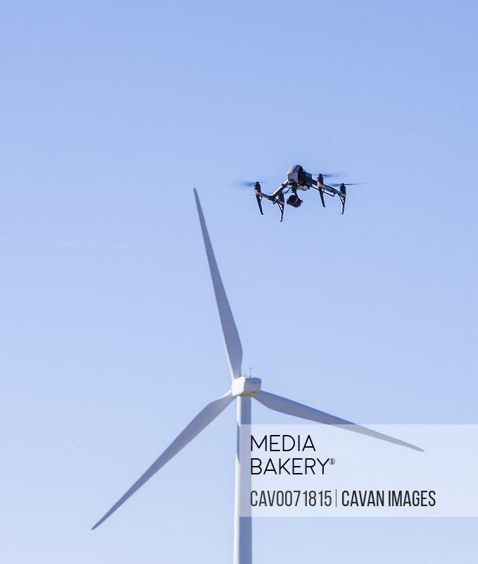 Wind turbines against blue sky video drone