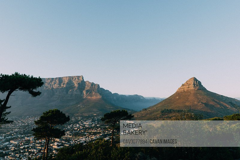 lions head mountain and table top mountain with city below as sunrises