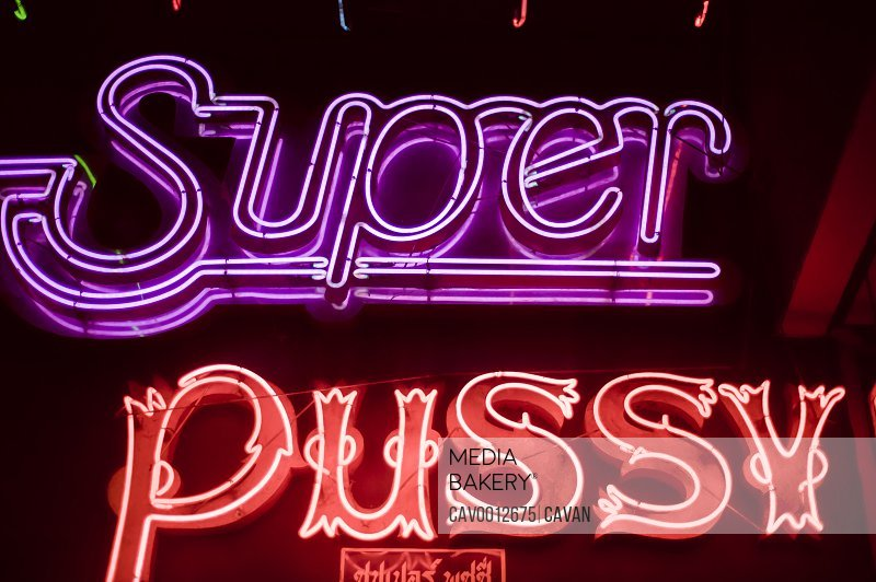 Nightclub neon sign in Silom neighborhood <br><br><span style='color: red'>Editorial Use Only.</span><br><br>