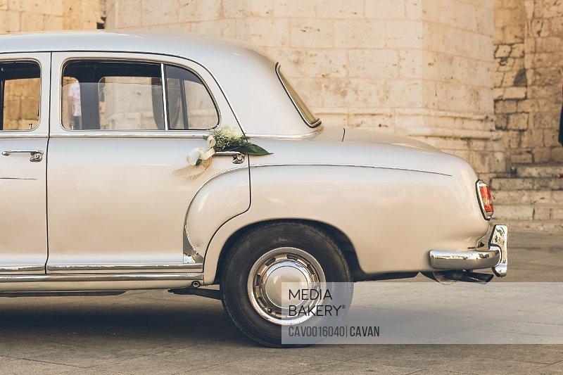 Back part of an old vintage fashion wedding car