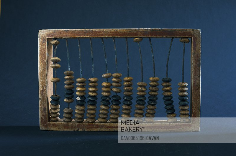 wooden abacus on a dark background
