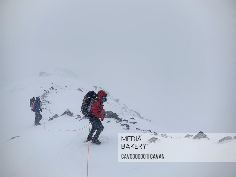 Climbers Brave the Elements as They Descend to Camp Muir on Mt Rainier<br><br><span style='color: red'>Editorial Use Only.</span><br><br>