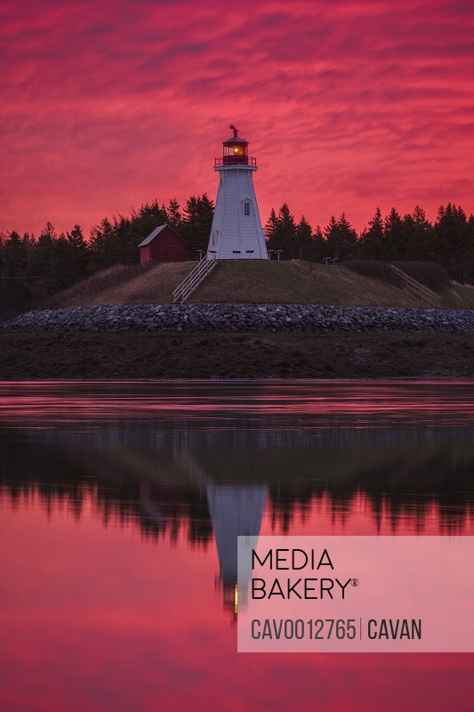 Dramatic red sky behind Mulholland Lighthouse in Canada