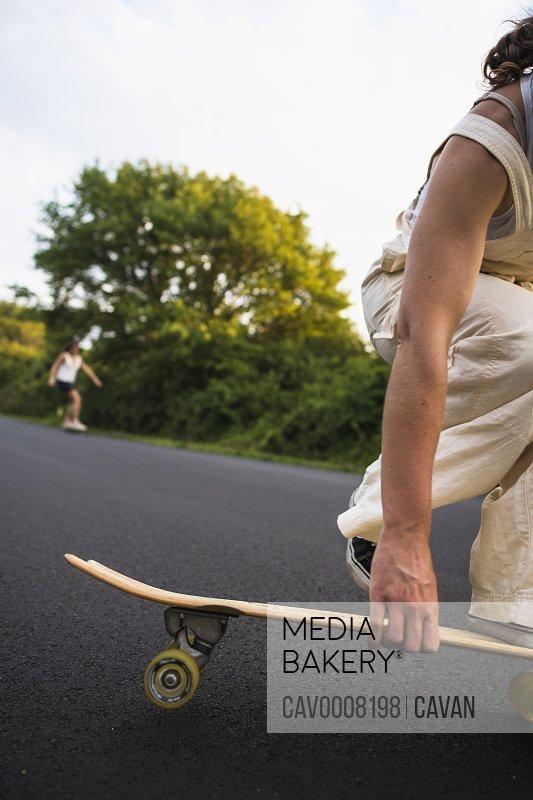 Young Women Skateboarding in Summer