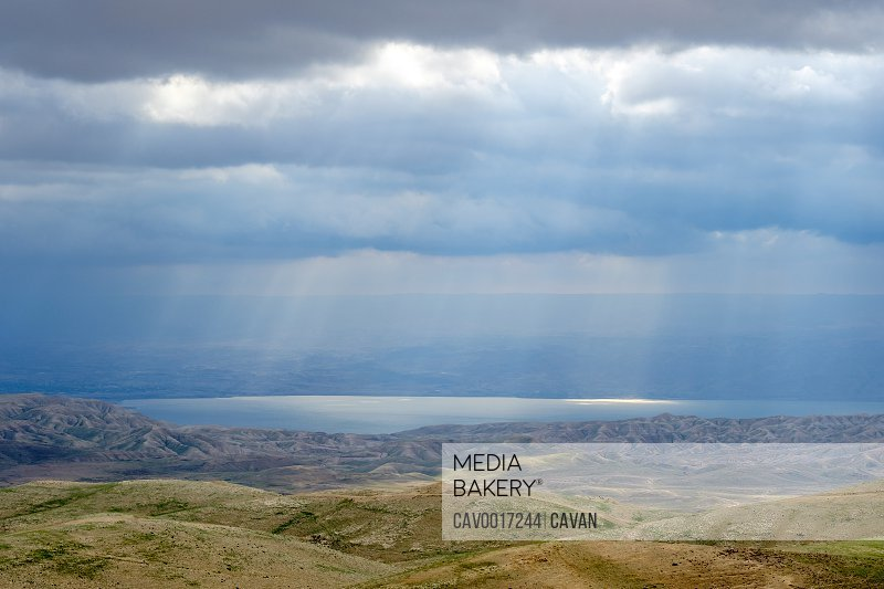 Sunbeams through storm clouds over the Dead Sea, Judean Desert, West Bank, Palestine