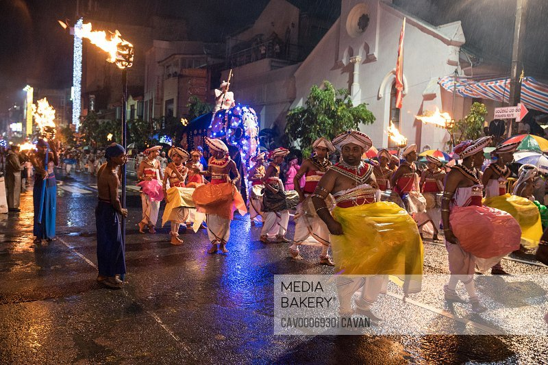 Group of men playing the drums under the rain in Kandy Esala Perahera<br><br><span style='color: red'>Editorial Use Only.</span><br><br>