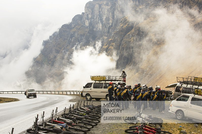 Tourists prepare to descend the infamous Death Road, near La Paz in Bolivia. It is reputedly the most dangerous road on the planet. A gravel track barely wide enough for two vehicles with dro<br><br><span style='color: red'>Editorial Use Only.</span><br><br>