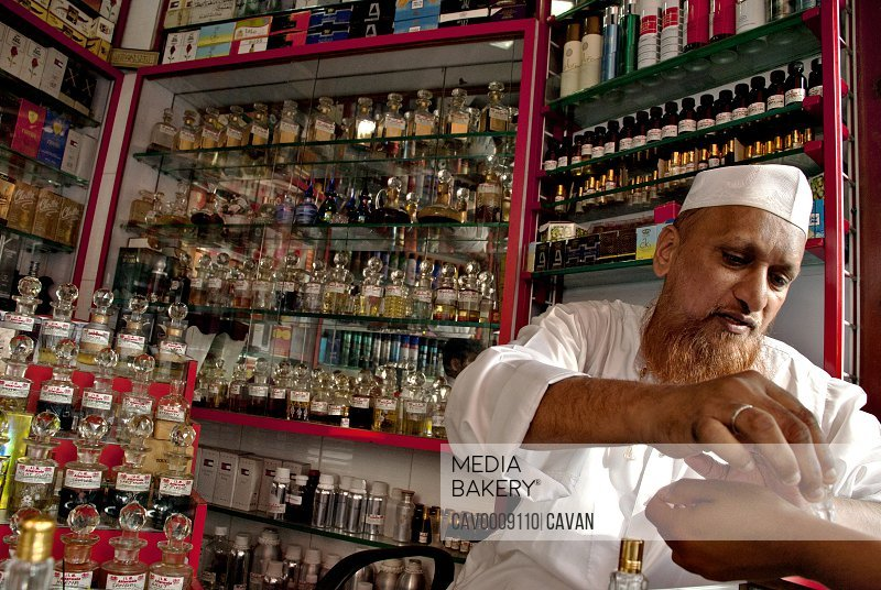 A perfume and essence muslim seller attends client <br><br><span style='color: red'>Editorial Use Only.</span><br><br>