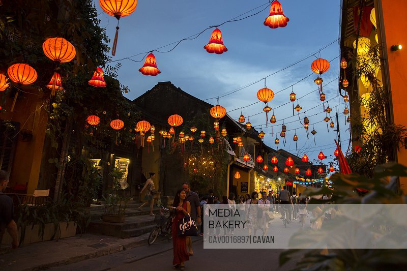 Colorful orange lanterns light up the night street in Hoi An, Vietnam. <br><br><span style='color: red'>Editorial Use Only.</span><br><br>