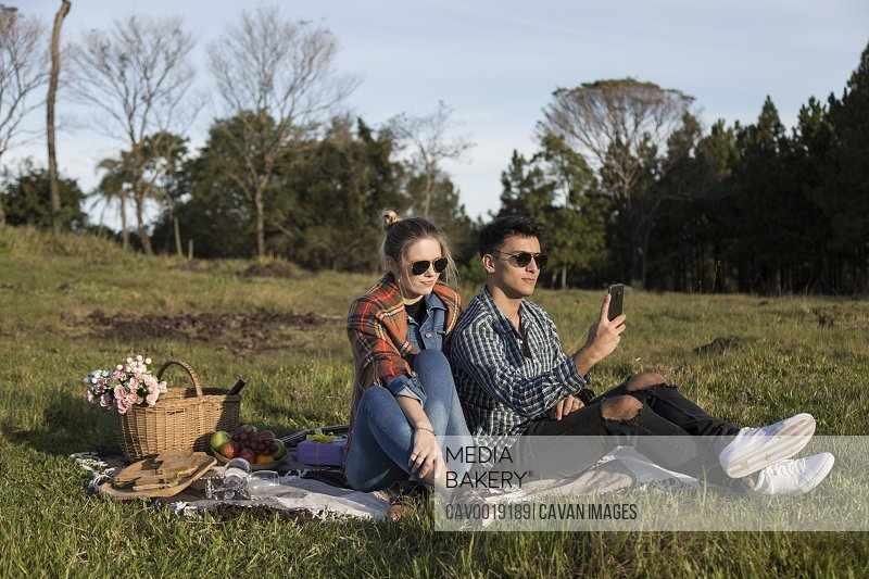 Beautiful Couple Taking Selfie In Nature