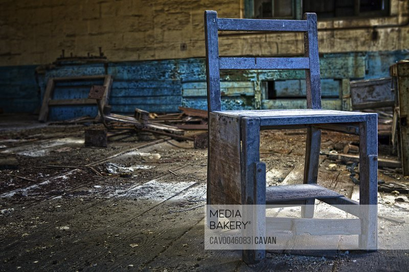 Old seamster's chair at abandoned Chinese sweat shop
