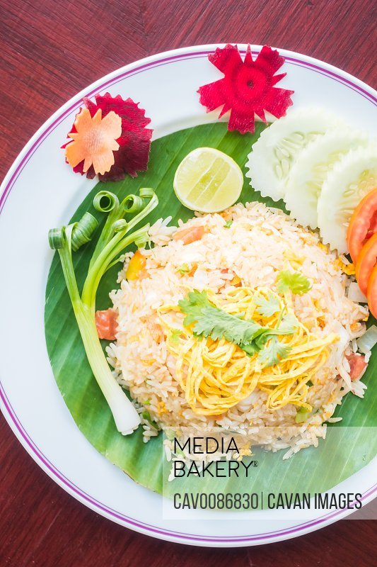 Selective focus point on fried rice in white plate with vegetable