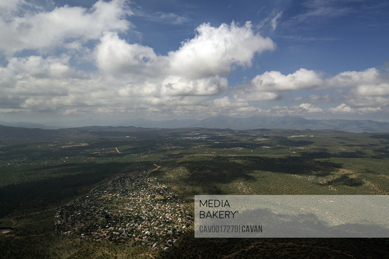 Aerial view looking down on a small village or town cloudy sky