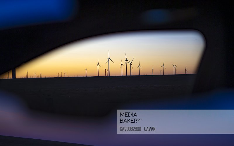 View of Colorado wind farm from an automobile side mirror
