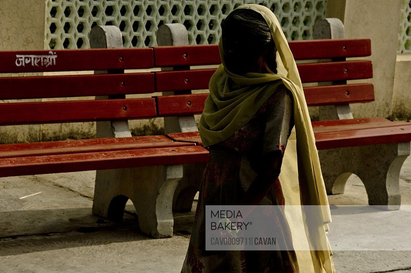 Indian woman wearing sari walking in train station <br><br><span style='color: red'>Editorial Use Only.</span><br><br>