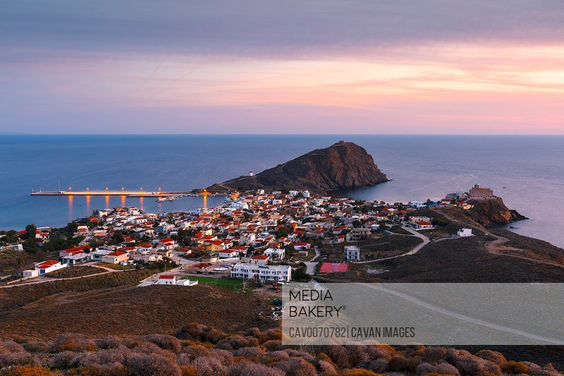 Image of Psara's main village and harbour at sunset.