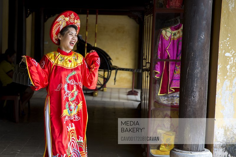 Woman in traditional Vietnamese clothing laughs. <br><br><span style='color: red'>Editorial Use Only.</span><br><br>