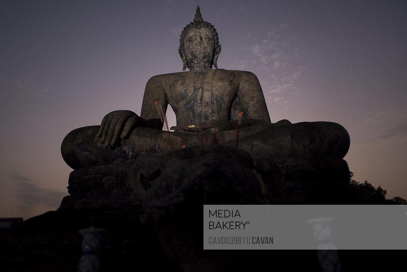 Buddha statue at the Wat Mahatat temple , Sukhothai Historical Park, Sukhothai, Thailand.<br><br><span style='color: red'>Editorial Use Only.</span><br><br>
