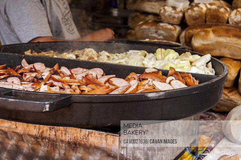 Grilled steamy Polish street food prepared locally, closeup
