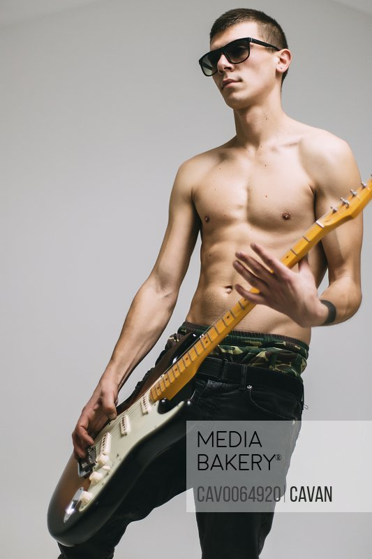 Close-up portrait of guitarist playing electric guitar